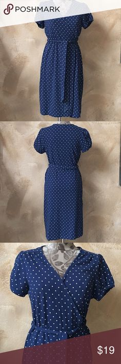 Lands End Navy Blue & White Polka Dot Wrap Dress Lands' End Navy Blue & White Polka Dot Wrap Dress   Size: 10-12 - True to size  Measurements can be provided upon request 📝  Fabric Content 👗 58% Cotton  Features ✨ •Comfortable and soft •Quality material that's made to last  •Wrap style with tie waist •Midi length •Great Used Condition  Get 15% off when you buy 3+ items plus save on shipping! 💸 Thanks for looking 💕 Lands' End Dresses Midi