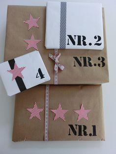 Stencil receivers intials and present number sequence, interesting concept. Wrapping Ideas, Wrapping Gift, Gift Wraping, Creative Gift Wrapping, Christmas Gift Wrapping, Creative Gifts, Pretty Packaging, Gift Packaging, Love Gifts