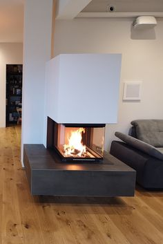 Floating panoramic fireplace with black fire table - - Floating Fireplace, White Fireplace, Modern Fireplace, Fireplace Design, Fire Table, Bedroom Loft, Glass Panels, Sweet Home, Living Room