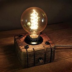 A wooden lamp, in the style of industrial, a steampunk for retro lamps EDISON. The lamp is made by hand from natural wood, polished and covered with Danish oil. Lampe Steampunk, Lampe Edison, Retro Lampe, Driftwood Lamp, Wooden Lamp, Room Lamp, Unique Lamps, Night Lamps, Lamp Bases