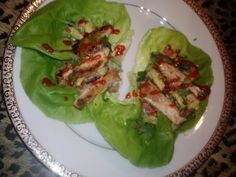 Less than 100 calories each! 20 min. total time! Grilled chicken over an avocado, tomato, red onion cilantro salad on butter leaf lettuce!
