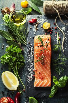 Delicious portion of fresh salmon fillet with aromatic herbs, spices and vegetab. - Delicious portion of fresh salmon fillet with aromatic herbs, spices and vegetables – healthy food, diet or cooking concept Salmon Recipes, Fish Recipes, Seafood Recipes, Healthy Recipes, Tilapia Recipes, Orange Recipes, Food Design, Food Shopping List, Food Porn