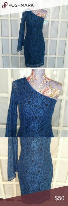 Marc New York Cocktail Dress GORGEOUS Gorgeous dress in a size 4. The material is a rayon blend with a polyester liner. It is a one shoulder Style the sleeve flares out at the bottom not fitted. The whole dress is a beautiful floral lace pattern in a stunning electric blue color. The zipper is on the side and fully functional. This dress is in excellent preowned condition. It does have some stretch to it as well. Message with any questions Andrew Marc Dresses One Shoulder
