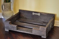 Small dog bed with a dark walnut stain.