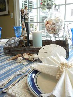 Like the jar of shells and the sailor couple. Coastal Colors, Coastal Decor, Place Settings, Table Settings, Nautical Table, Centerpieces, Table Decorations, Coastal Christmas, Coastal Living