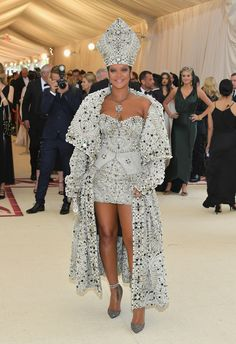 Rihanna in custom Maison Margiela by John Galliano, Christian Louboutin shoes, Maria Tash jewelry, Cartier jewelry, and a custom Judith Leiber Couture clutch.
