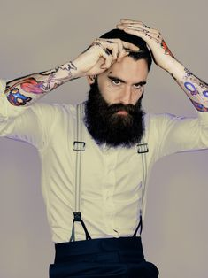 I don't dig the tattoos but the beard is excellent. Nice braces too.
