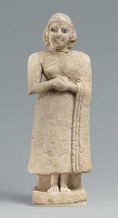 Standing female worshiper Period:Early Dynastic IIIa Date:ca. 2600–2500 B.C. Geography:Mesopotamia, Nippur Culture:Sumerian Medium:Limestone, inlaid with shell and lapis lazuli Dimensions:H. 9 13/16 x W. 3 3/8 x D. 2 1/8 in. (24.9 x 8.5 x 5.4 cm) Classification:Stone-Sculpture