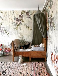 Marie Olsson Nylander // vintage kids room with floral wallpaper, olive green canopy, and antique wood bed