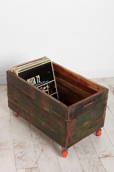 wooden crate with wheels used as magazine rack, vinyl record storage, etc.
