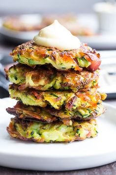 These savory bacon zucchini fritters are easy to make, packed with veggies and downright addicting! They're delicious served as a side dish or appetizer with homemade ranch dip. These tasty fritters are also paleo, friendly, gluten free and dairy free. Paleo Zucchini Fritters, Bacon Zucchini, Potato Fritters, Bacon Egg, Paleo Zucchini Recipes, Veggie Fritters, Turkey Bacon, Easy Healthy Recipes, Healthy Recipes