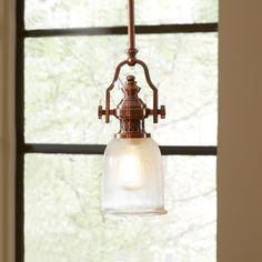 One thing I definitely want in our new kitchen is some awesome pendant lighting over the island. In addition to brightening up the space, it's a chance to add a unique design element to our kitchen. Without further ado... here is a round up of my favorite kitchen pendant lights. I'd be thril