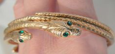 Offering Delightful Vintage Jewelry Treasures. Often rare pieces for those  who crave the unique Saucy six headed green eye Snake Bangle Bracelet Excellent condition