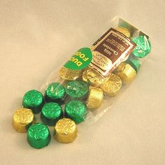 """Eugene,OR- Euphoria Chocolates- """"Duck Food"""" individual milk chocolates wrapped in green and yellow foils.  $0.35 (sold individually)"""