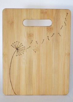 dandelion woodburned bamboo cutting board More