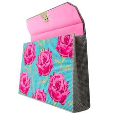 Plastic canvas clutch. This is really pretty and fairly modern. Someone really needs to come up with some modern plastic canvas crafts...
