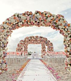 Bahamas wedding with three full arches of flowers!