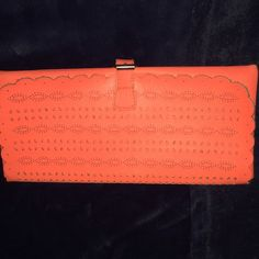 Adorable coral/orange clutch Bright neon coral / orange clutch! Great condition American Eagle Outfitters Bags Clutches & Wristlets