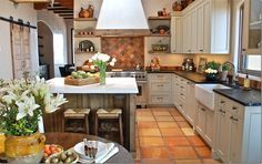 terra cotta floor lends itself to provence-like rustic dining room/décor-style