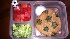 Soccer-themed lunch. Sandwich thins colored with food-safe markers to look like a soccer ball, watermelon with soccer food pick, broccoli with ranch dip (under the sandwich).