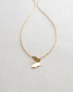 Butterfly Necklace - gold or silver petite butterfly charm adds an ultra feminine touch to any outfit. By Olive Yew.