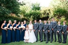 Navy, long bridesmaids dresses and blush pink wedding details - white bouquets - grey groomsmen suits - grey, navy and pink details