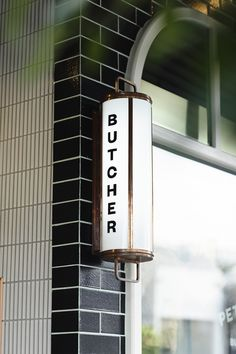 Fiona Lynch - Butcher Shop A sophisticated black and terracotta frontage references the heritage and quality of the new-look Peter G Bouchier Butcher Shop.