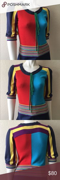 """Marc Jacobs Sweater Marc Jacobs Sweater comes in a color block print, 3/4 length sleeves. Size: S Bust: 32""""-34"""" Length: 22"""" Shoulder to Shoulder: 13"""". Can fit an XS. In excellent condition. Marc Jacobs Sweaters Crew & Scoop Necks"""