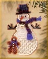 Mill Hill Gingerman Snow Charmer - Beaded Cross Stitch Kit. Kit includes glass beads, petite charm, perforated paper, floss, needles and chart with instructions