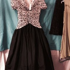 "Promo-dressNWT Black satin dress with tule polka dot top.Linning and petty coat .size 7-8,.Waist line is 28-29"". Length from shoulder down is 51"" long. Dresses Midi"