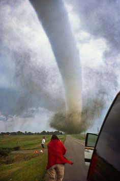 A photographer captures the deployment of a scientific weather probe in the path of an oncoming tornado near Manchester South Dakota on June An astounding pressure drop of 100 millibars was recorded as the tornado passed over the device. Weather Storm, Weather Cloud, Wild Weather, All Nature, Science And Nature, Amazing Nature, Tornados, Thunderstorms, Severe Weather
