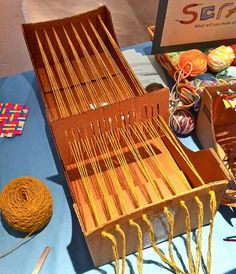 awesome DIY cardboard loom.  maybe I can finally make that scrap fabric rug...