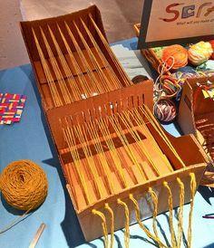 awesome DIY cardboard loom.  maybe I can finally make that scrap fabric rug...
