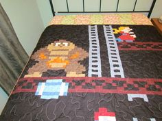 It's been a while since I've seen a really cool video game inspired quilt, so I was happy when I saw this one, which looks just like the game screen from the original Donkey Kong.