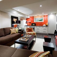 Spiced up basement ..... Candice Olson design that creates a space with energy & warmth.