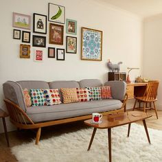 Glorious #vintage style - #ercol + fabric cushions + gallery wall