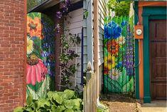 Painted gates in Buffalo's Cottage District. Garden Fence Art, Garden Mural, Porch Garden, Garden Gates, Mackenzie Childs Inspired, Donor Wall, Desert Botanical Garden, Building A Fence, Climbing Vines
