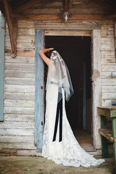 Rebecca Schoneveld Gown with navy sash from Faith Thornburg | Izzy Hudgins Photography + Ivory and Beau | see more on: http://burnettsboards.com/2014/07/12-ways-accessorize-wedding-dress/