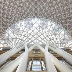 Semi-circular vaulted concourse designed by British architects John McAslan + Partners at King's Cross Station, London
