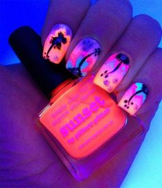 A Hawaiian sunset using neon pinks and oranges, and a black palm tree as an accent.