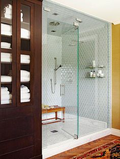 Love the tile design in walls in this shower .from BHG online mag_Stylish Bathroom Color Schemes-Tan + Smoke Gray + Mahogany