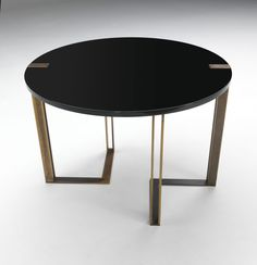 The structure of the Black and Gold Round Table pieces are in metal, with a galvanized opaque, iridescent brass finish and the surface and doors are painted shiny black gloss. Dining Table Design, Dinning Table, Round Dining, Console Table, Dining Room, Round Black Coffee Table, Art Deco Coffee Table, Gold Table, Center Table