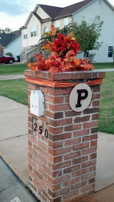 Brick mailbox decorated for fall.