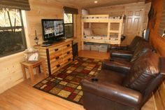 A Payton Place - Newly remodeled 1 bedroom park model cabin with a brand new game room including dart board and a old school arcade game.This cabin is ideal for three couples or a family of six.