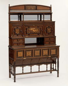 "1875 British Cabinet at the Museum of Fine Arts, Boston - From the curators' comments: ""Talbert, a leading proponent of the Gothic Revival style, was one of many prominent designers influenced by Japanese ornament....This display cabinet combines both Asian and medieval European stylistic elements, expressed in the sophisticated use of contrasting wood veneers."""
