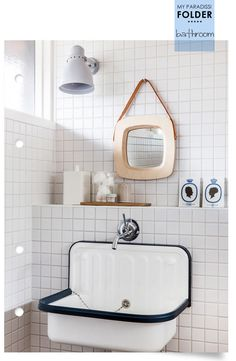 Wall mounted enamel sink in a modern retro bathroom.