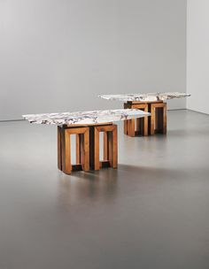 Pair of large walnut consoles with Fior di pesco marble tops by Pierluigi Spadolini (circa 1965).
