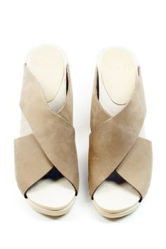 e71713686cb94 Slide into style with the Criss Cross Clogs from Sven. Featuring an open  toe