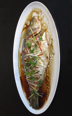 Fish Make a traditional Chinese steamed fish for a low-calorie, high-protein dinner.Make a traditional Chinese steamed fish for a low-calorie, high-protein dinner. Fish Dishes, Seafood Dishes, Fish And Seafood, Seafood Recipes, Cooking Recipes, Healthy Recipes, Tilapia Recipes, Salmon Recipes, Crockpot Recipes