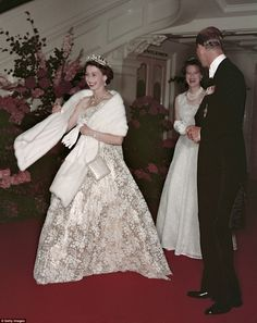 As a glamorous monarch, Queen Elizabeth II wowed the Australian crowds in this lace one-shouldered dress with dazzling royal jewelry, as she is pictured leaving a banquet with Prince Philip during their inaugural 1954 Australian tour. Queen Elizabeth Birthday, Queen Elizabeth Ii, Princesa Diana, Queen Fashion, Royal Fashion, Royal Queen, King Queen, Prinz Philip, Royal Families